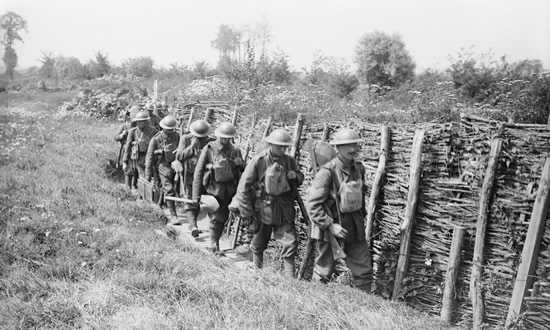 Irish Guards going up a communication trench. Image: John Warwick Brooke [Public domain]